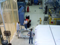 Preparing to open Swift spacecraft delivery crate.
