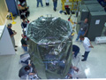Swift spacecraft being lifted out of its delivery crate.